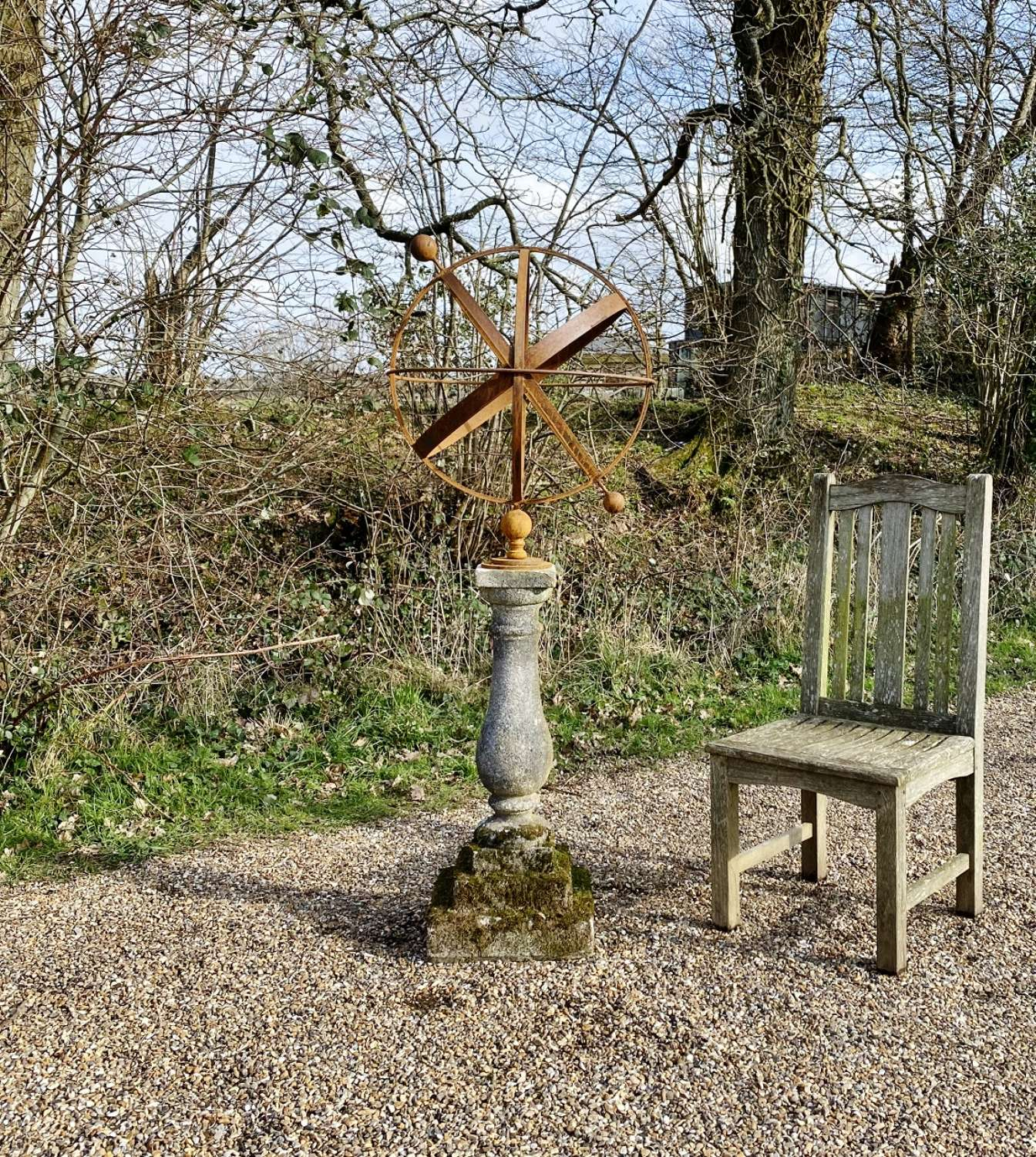 Rusted Armillary on Mossy Base