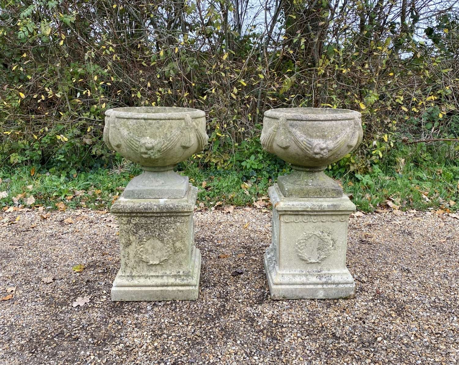 Pair of Small Goblet Urns with Pedestals