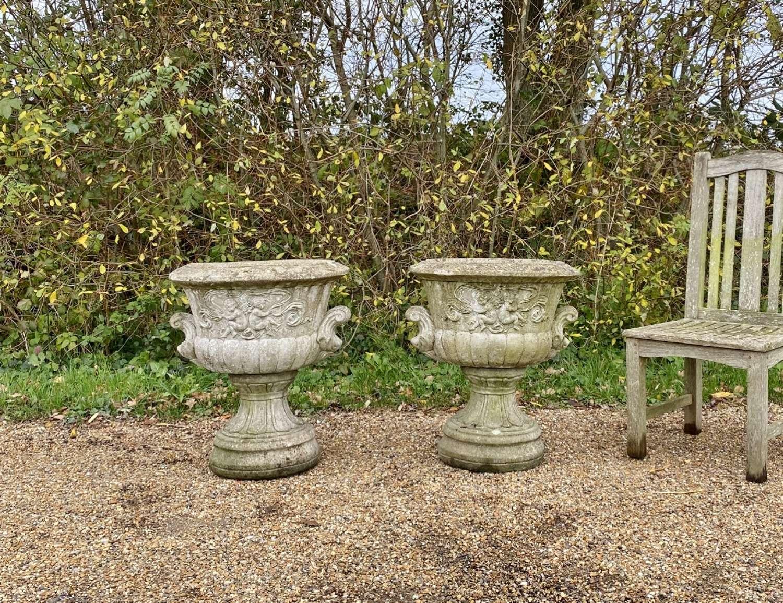 Pair of Large Cherub Urns