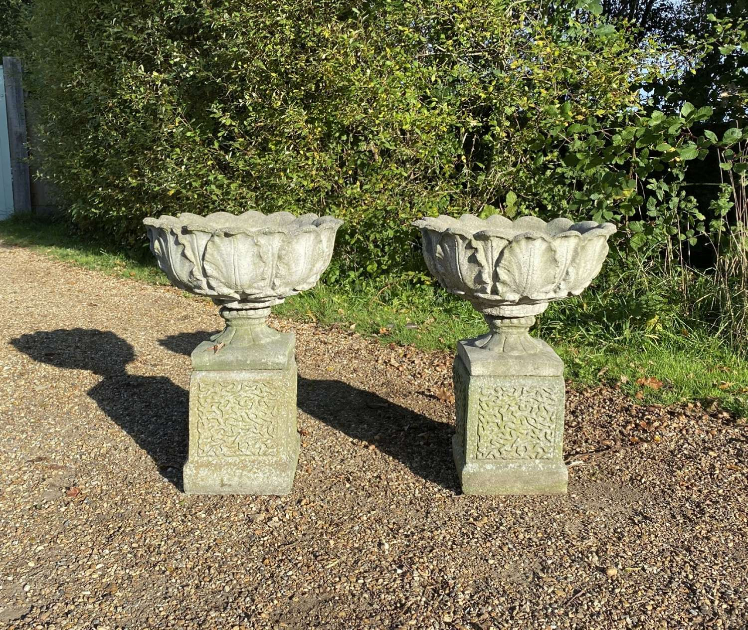 Pair of Acanthus Urns with Bases