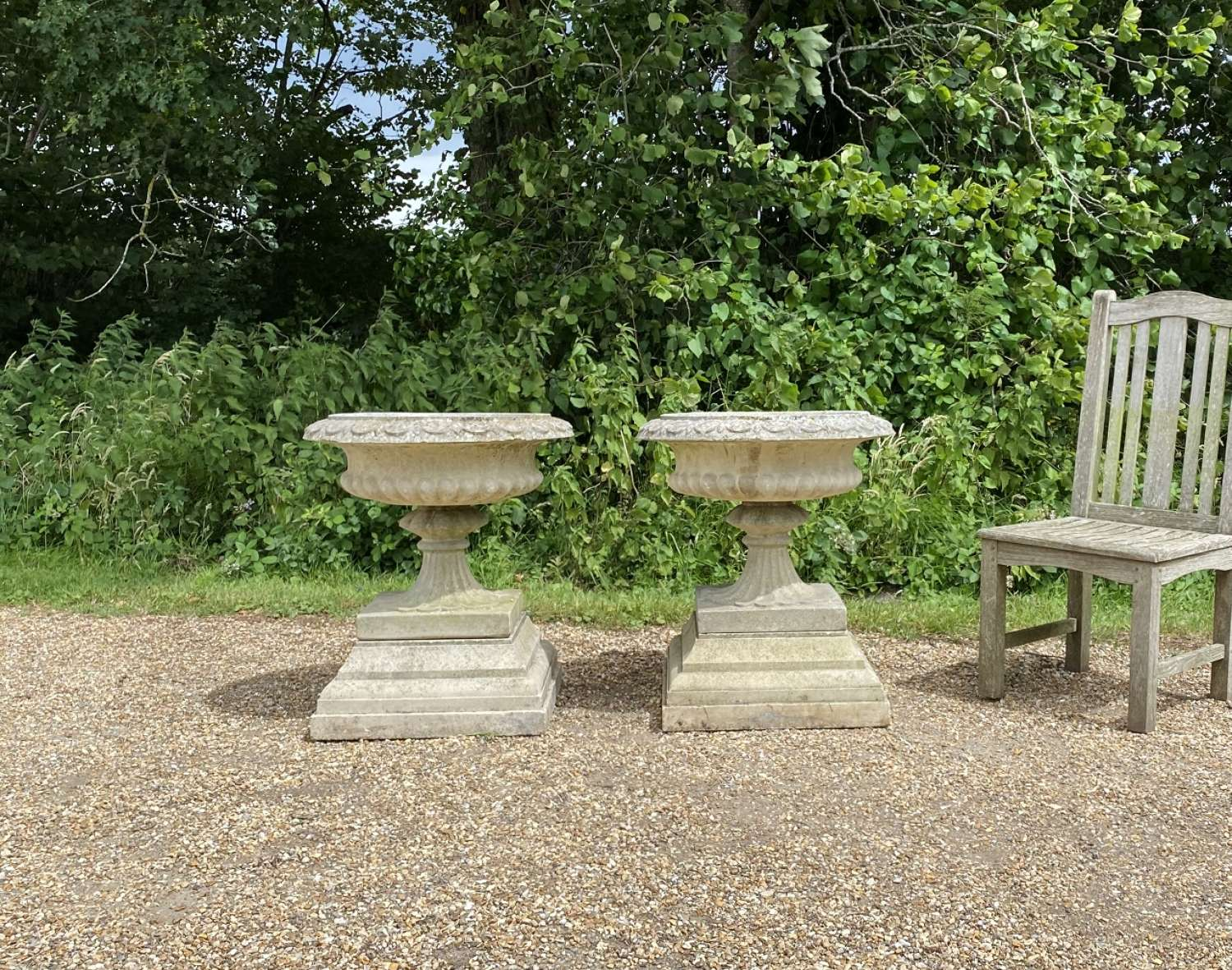 Pair of Sandford Urns with Plinths
