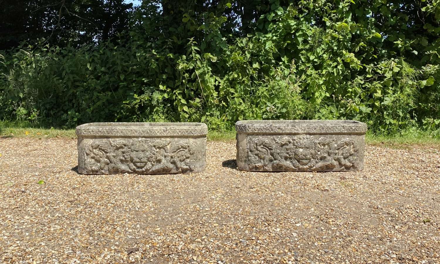 Pair of Patinated Lion Troughs