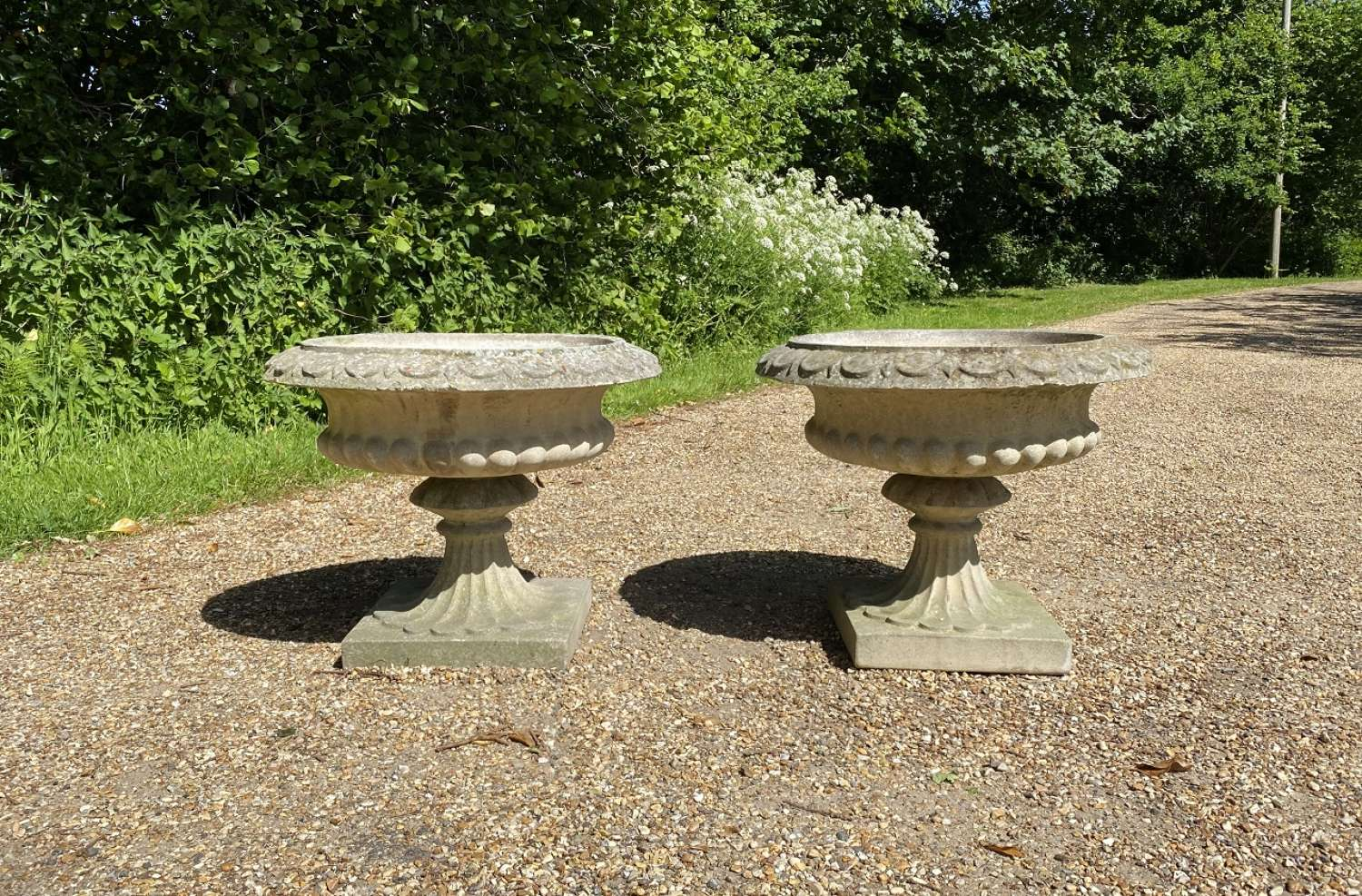 Pair of Sandford Stone Urns