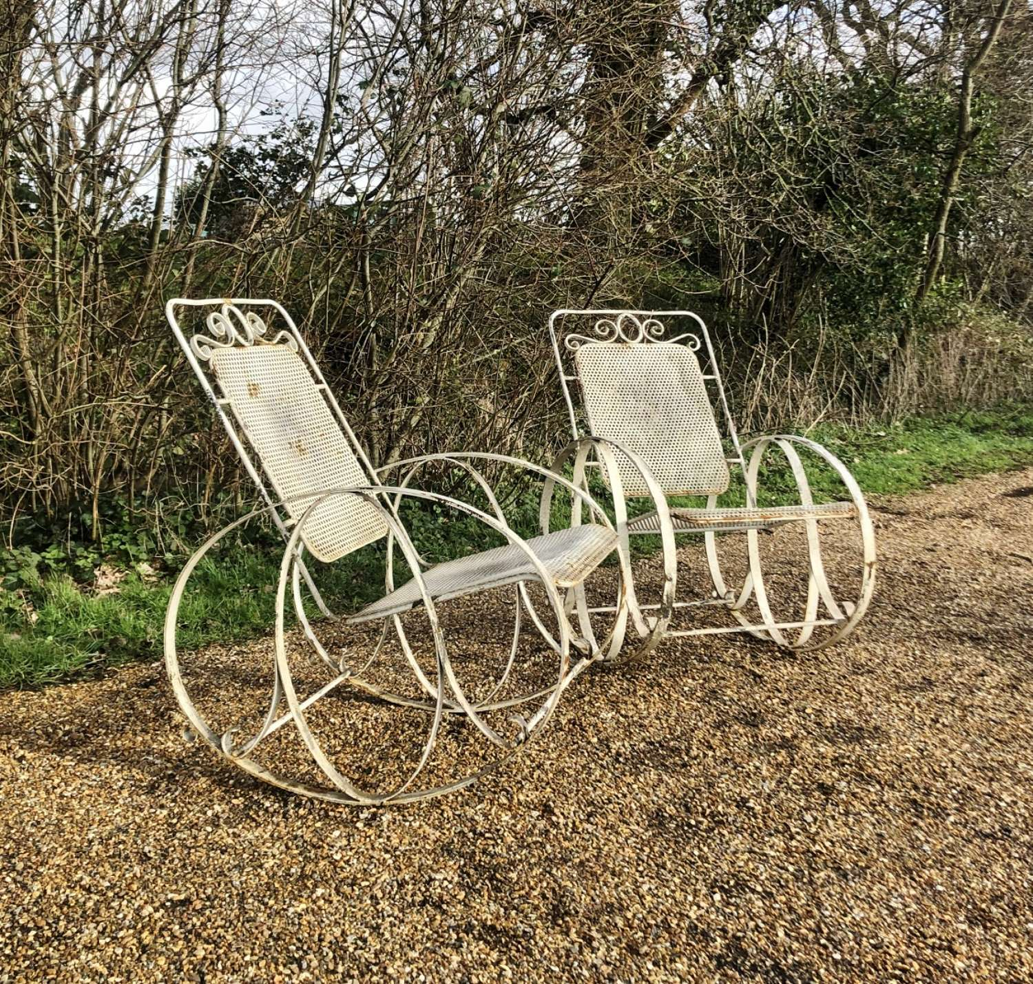 Pair of Large Iron Rocking Chairs