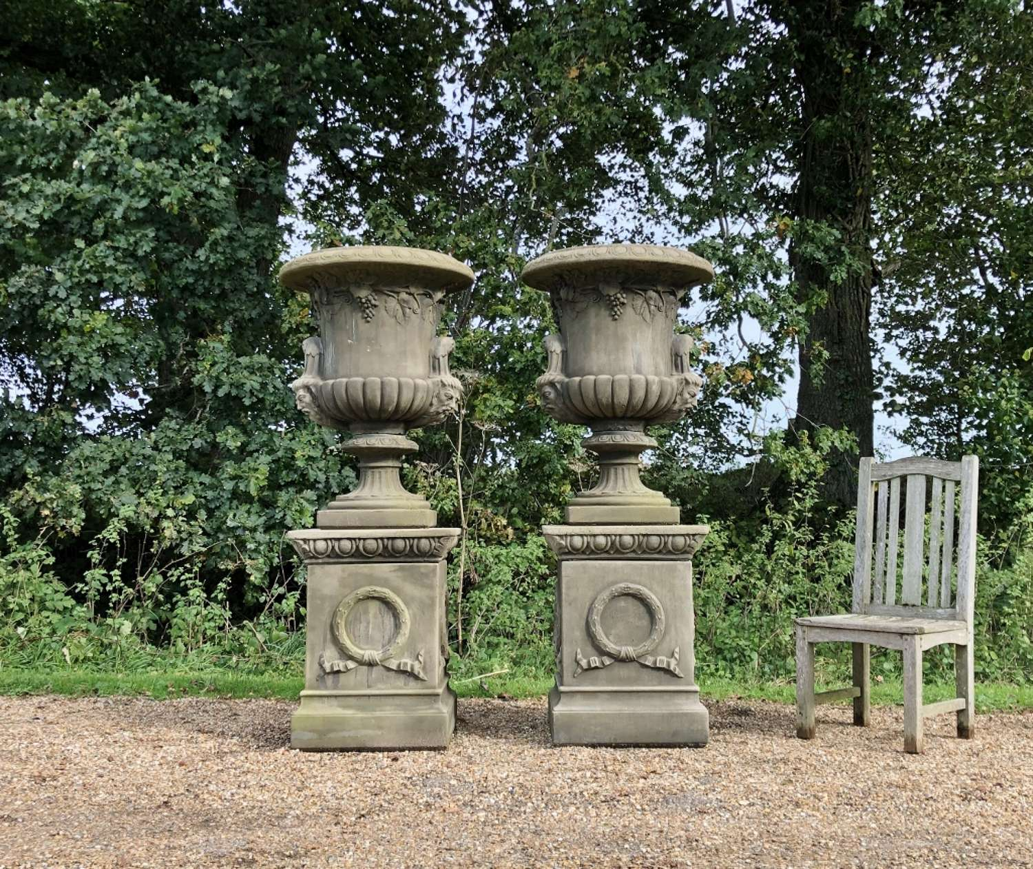 Large handled Urns on Pedestals