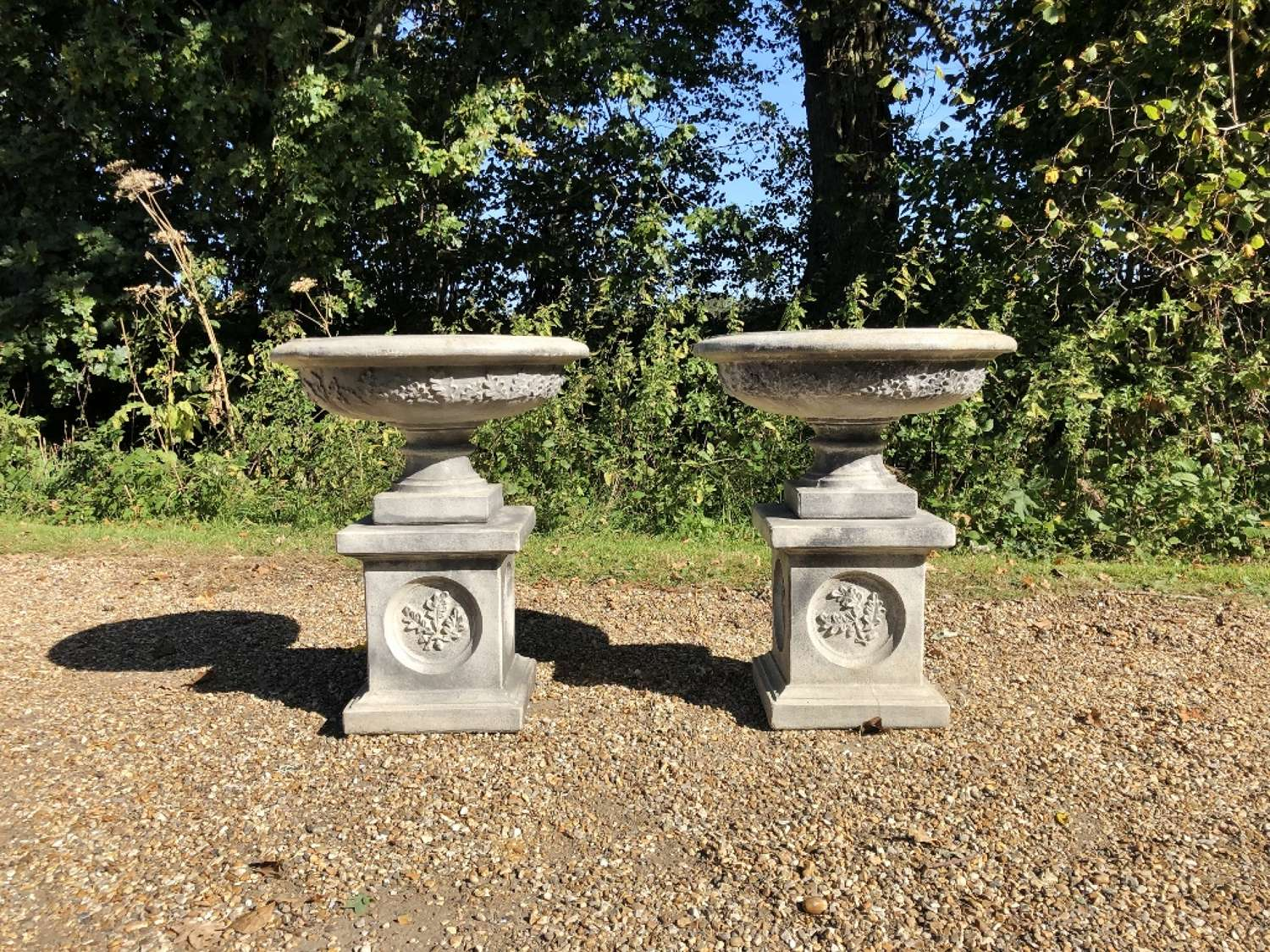 Pair of Small Oak Leaf Urns and Pedestals
