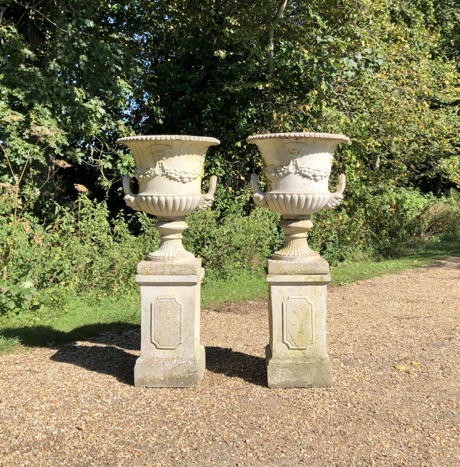 Pair of Handled Urns with Pedestals