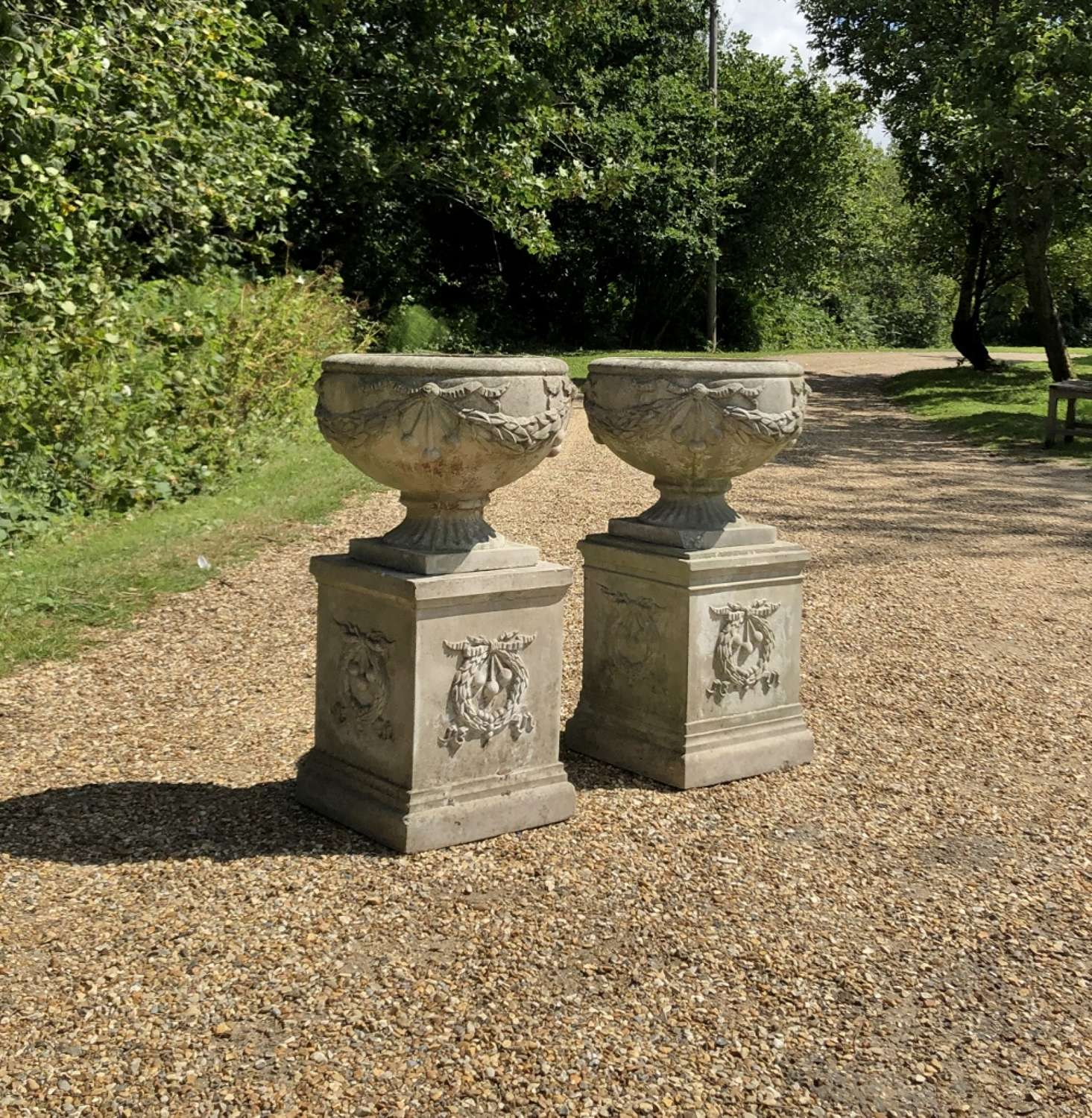 Pair of Small Cherry Urns and Pedestals
