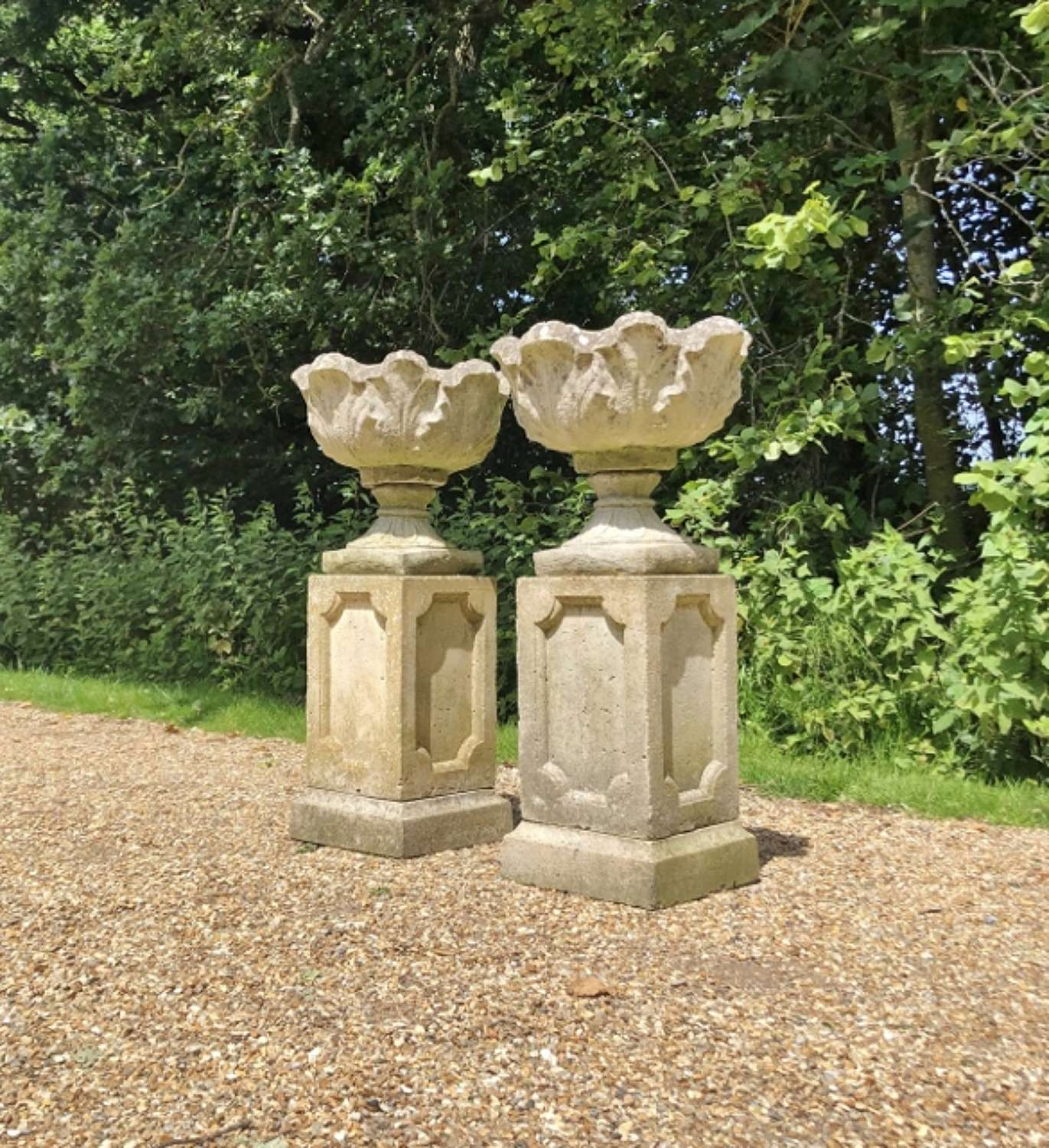Pair of Acanthus Urns with Pedestals