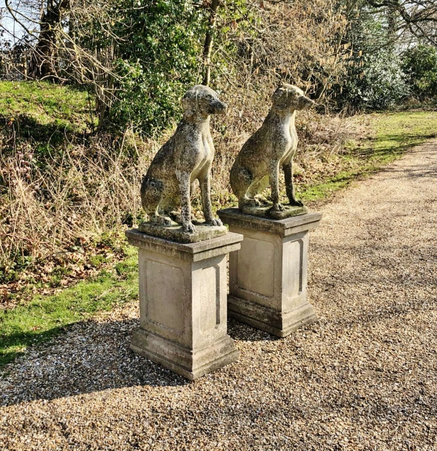 Pair of Patinated Dogs with Pedestals