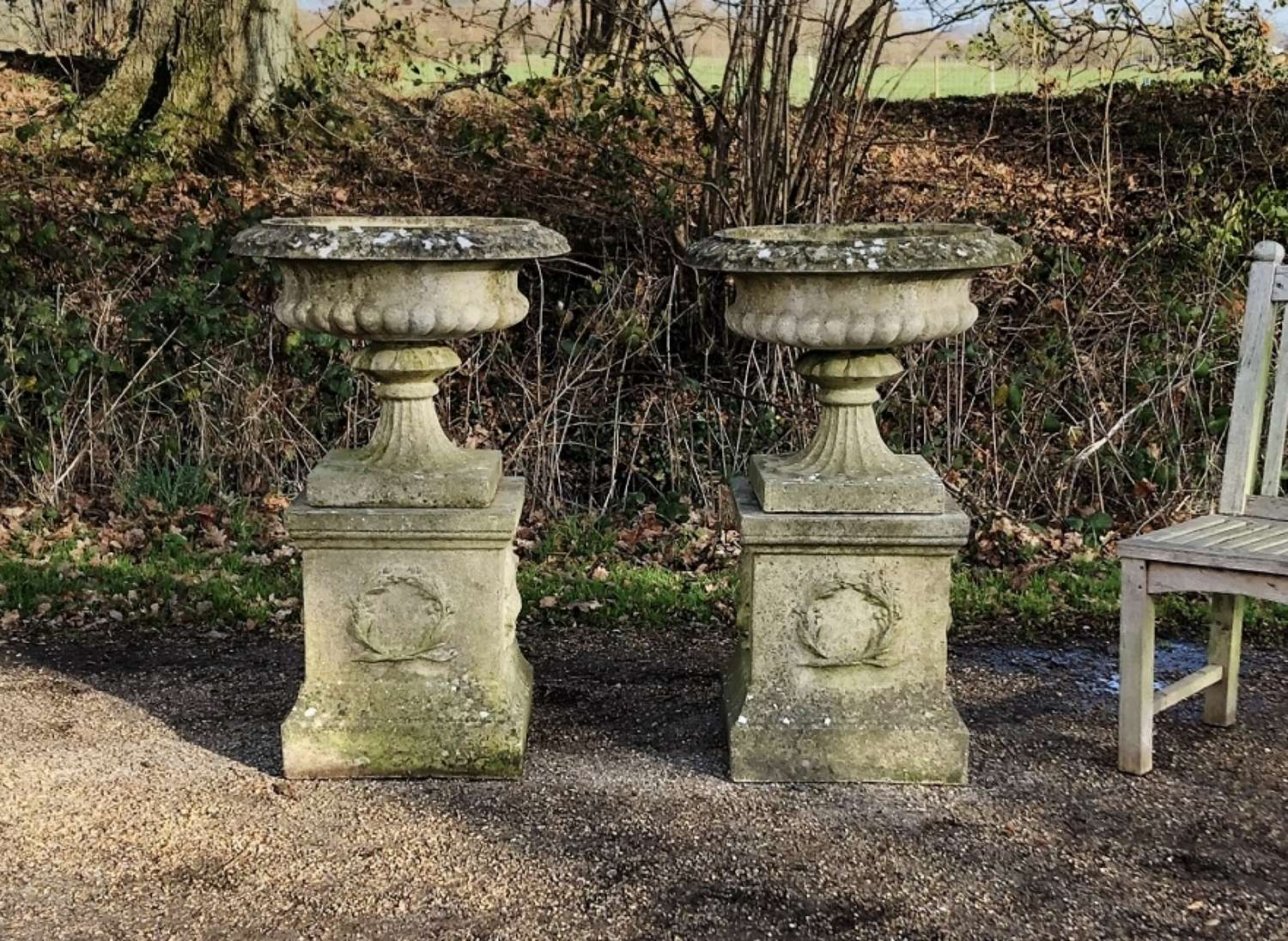 Pair of Large Sandford Stone Urns and Pedestals