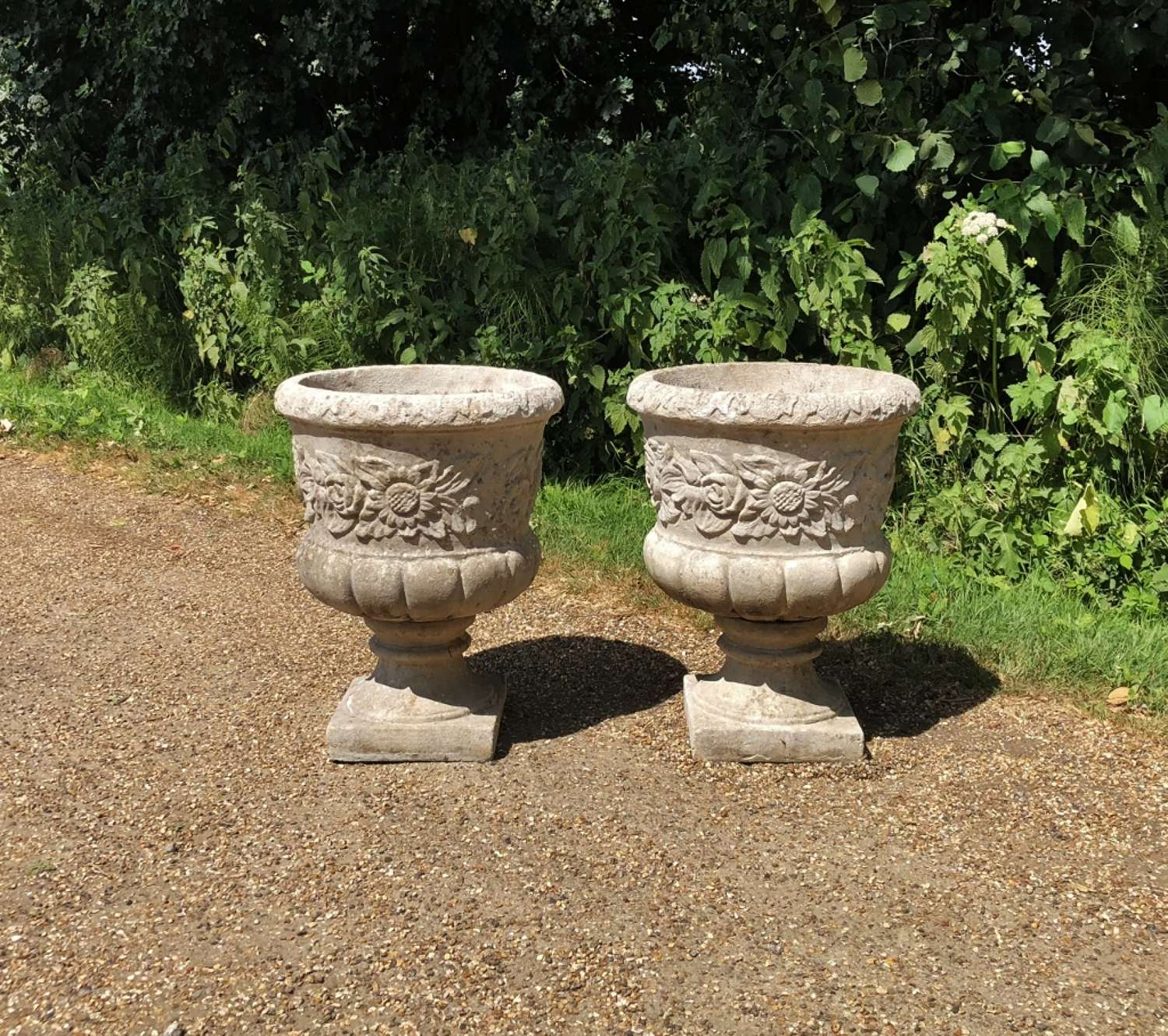 Pair of Large Flower Urns