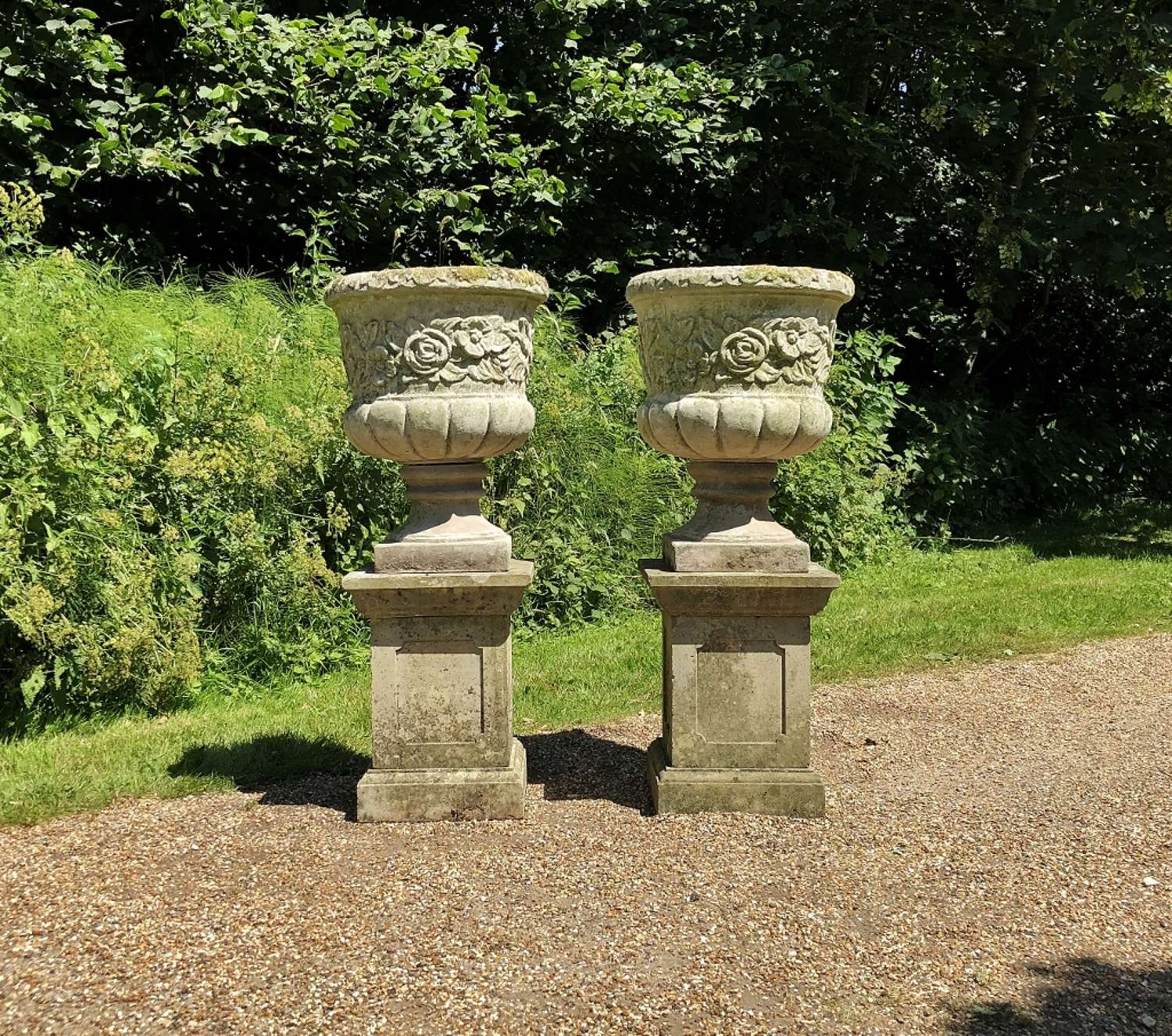 Pair of Large Flower Urns with Pedestals