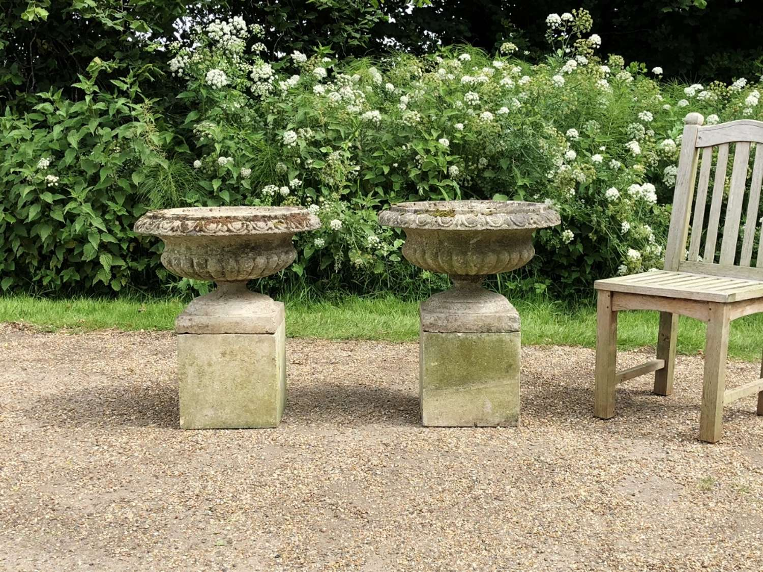 Pair of Urns on Low Pedestals