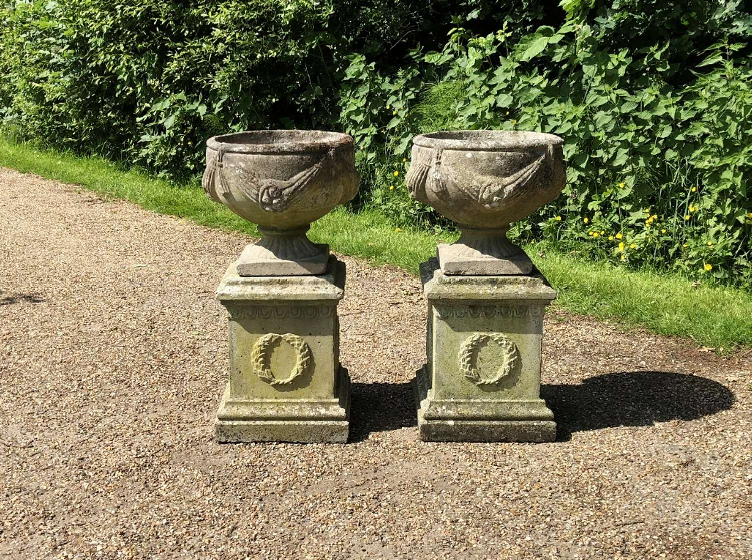 Pair of Goblet Urns with Pedestals