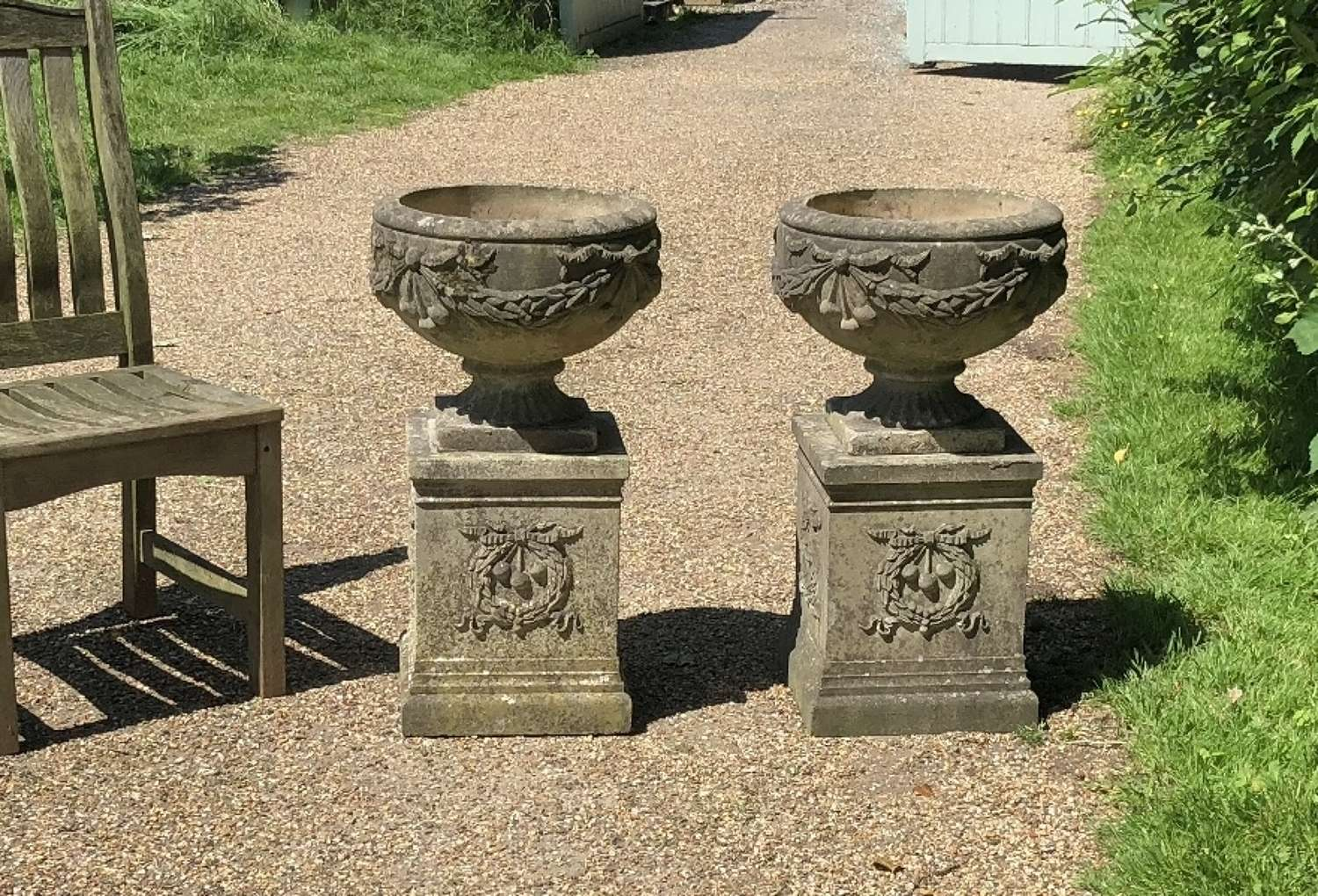 Pair of Decorative Goblet Urns with Pedestals