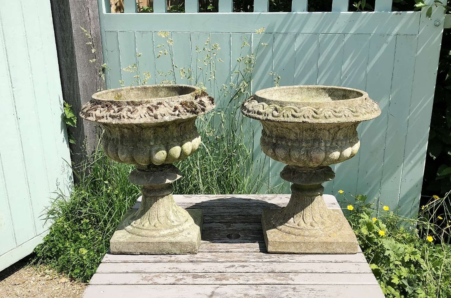 Pair of Small Weathered Urns