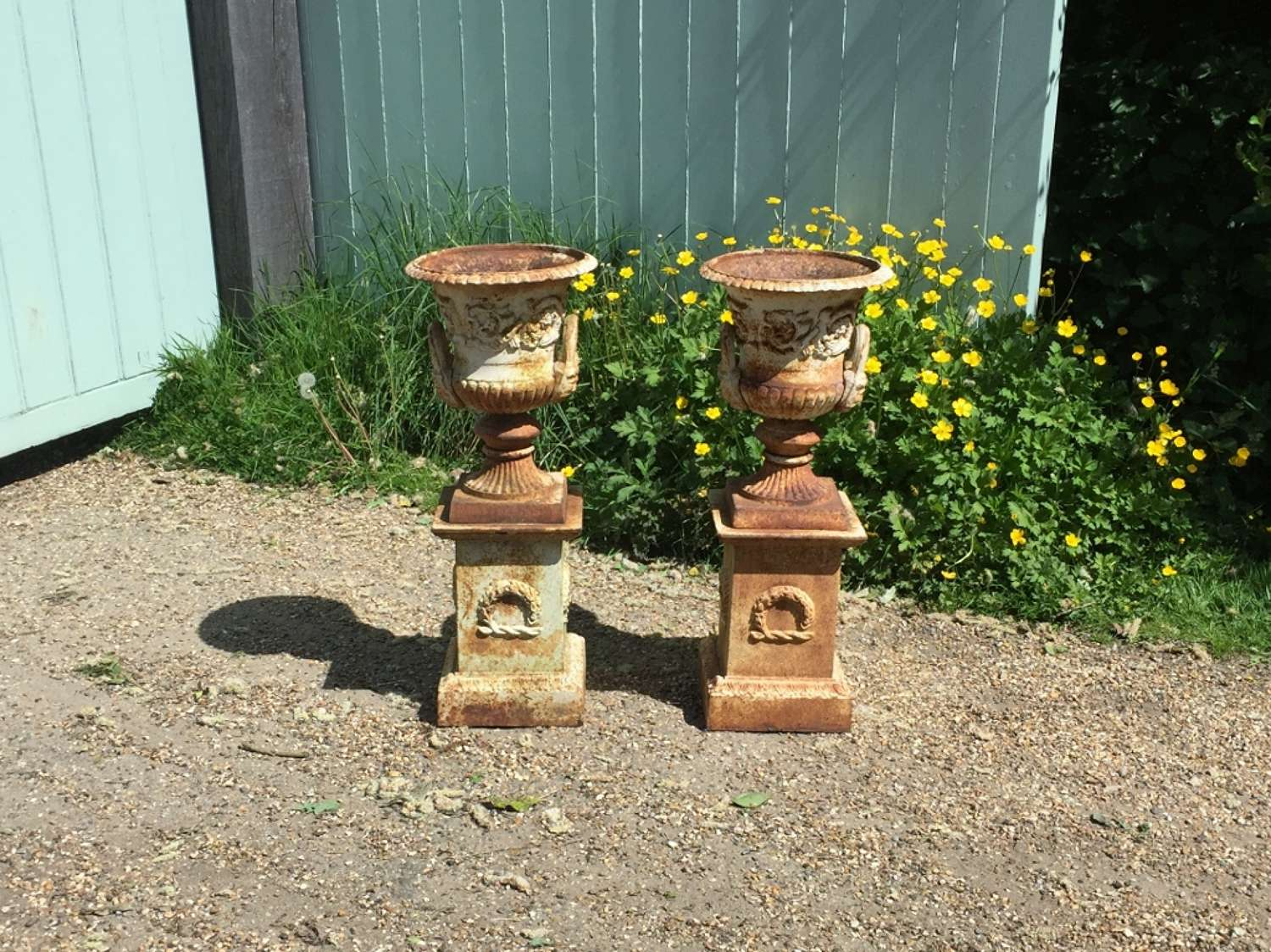 Pair of Small Iron Urns with Pedestals