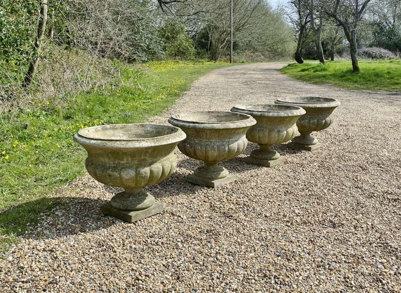 Set of 4 Patinated Urns