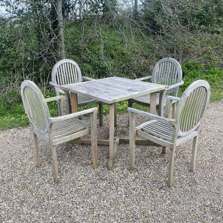 Table with 4 Round Back Chairs