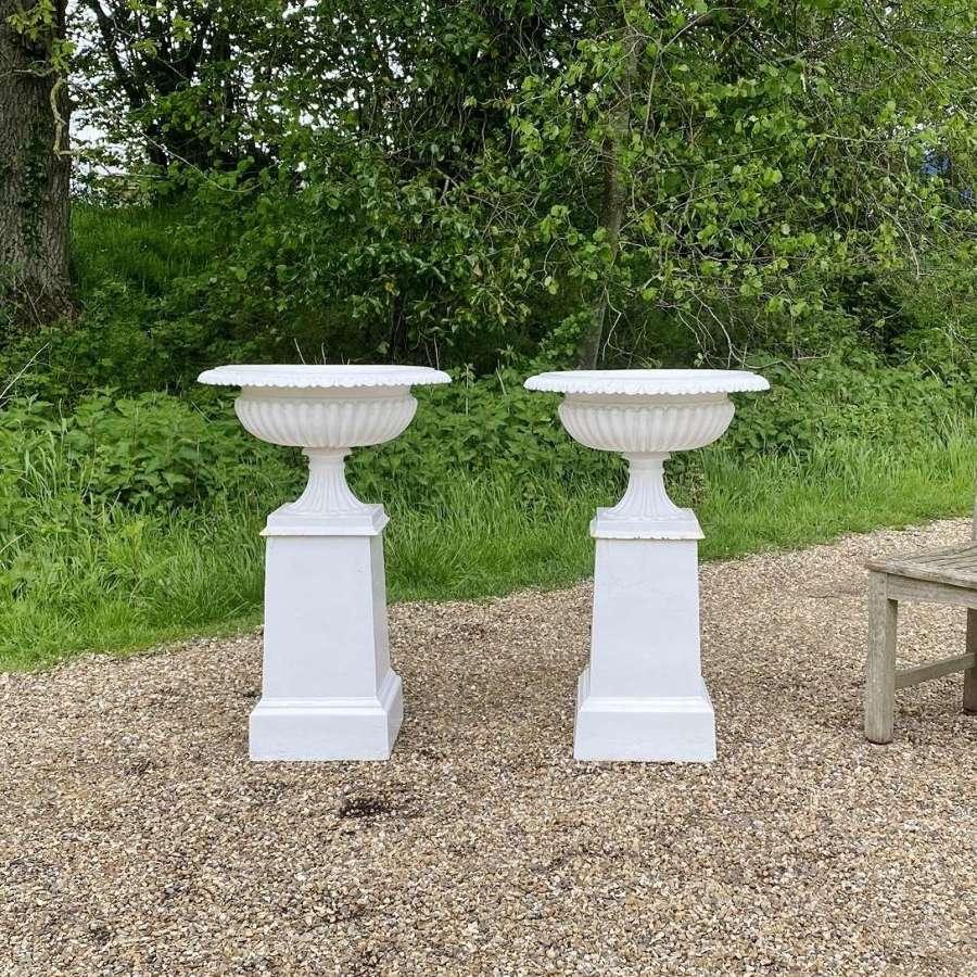 Pair of Mid-Century Iron Urns with Pedestals